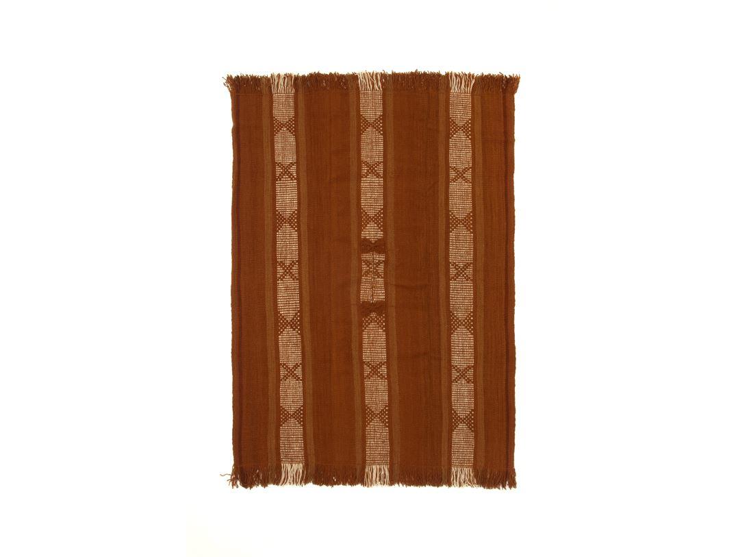 Poncho tradicional teñido vegetal